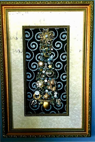"Schultz-Framed picture of ""jewelry tree""."