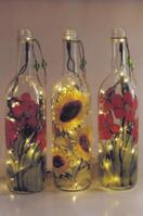 Higgins, Lighted Bottle Lamps, Variety of designs Hand Painted on wine bottles with lights.