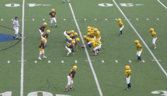 football players scrimmage