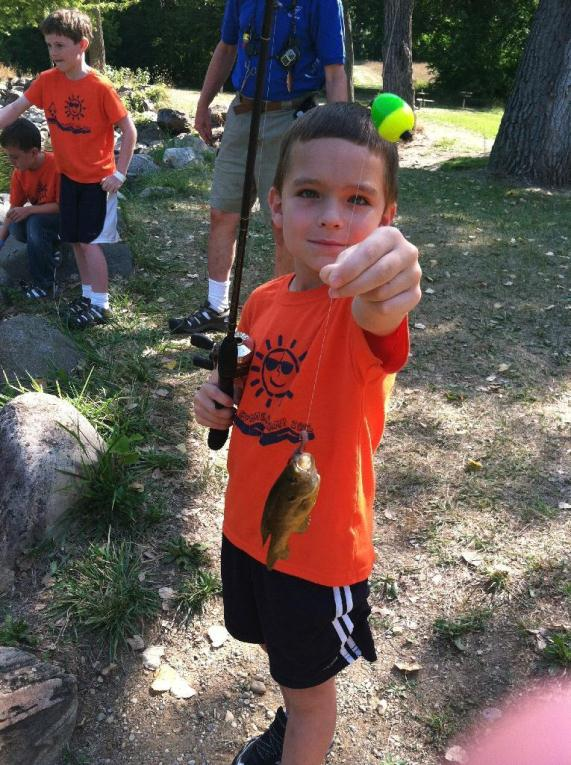 a boy with a fish he caught