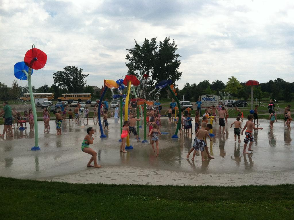 kids playing at a water playground