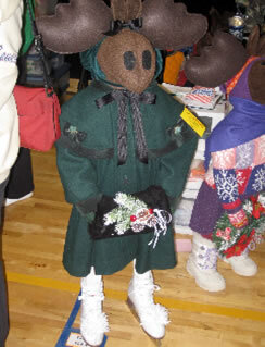 Brummeler's Stuffed Moose Wearing Skates and Green Winter Dress Coat