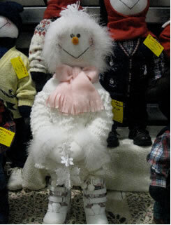 Brummeler's Stuffed Snowperson Wearing Fur-lined Winter Sweater and Pink Scarf