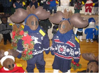 Brummeler's Stuffed Moose Couple Wearing Winter Sweaters and Christmas Adornments