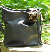 Geiger handmade Slouchy Hobo Style purse, featuring hand made leather flower embellishment