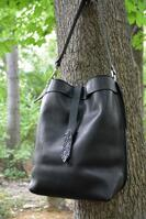 Geiger handmade  Black  Leather Hobo style purse, featuring a slide in tab closure