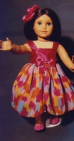"Ehrenfeld's 18"" Doll Dress, Pink Satin Bodice and Patterned Skirt with Pink Satin Hair Ribbon"