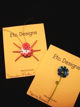 Favour's Wire and Metal Jewelry; Blue Flower on Single Stem Pin; Pink Insect with Antenna