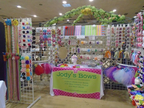 Feldkamp's Booth Set-Up featuring colorful bows and headbands.