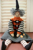 Revill's Witch doll hand and machine sewn using cotton and wool fabrics and yarns.