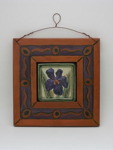 "Gertig's 4"" stoneware iris tile installed in a hand-made and hand-painted wooden frame."
