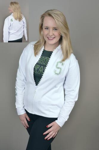 Kelly embellished white athletic jacket and green Michigan State tshirt.