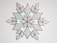 Renee Urban's medium size, iridized, stained glass snowflake.