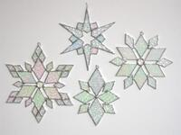 Renee Urban's iridized, stained glass snowflakes.