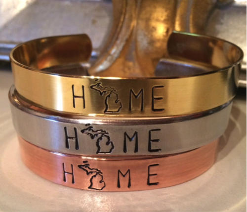 Ware handmade metal cuff bracelets with Michigan Home imprinted.