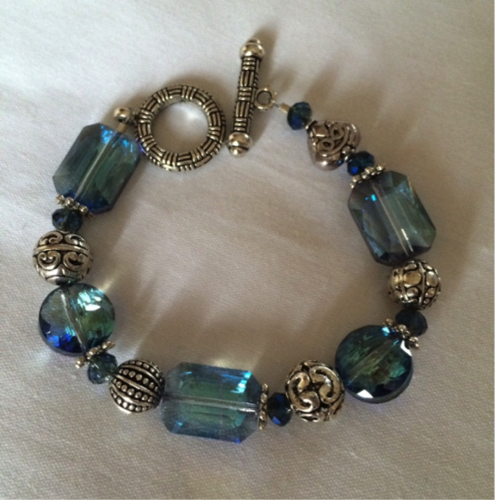 Ware handmade silver and glass bead bracelet.
