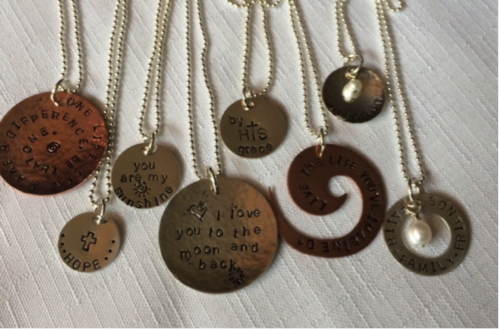 Ware handmade metal pendant necklaces with motivational wording.