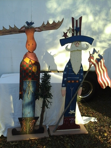 Youtsey handpainted wooden moose and Uncle Sam.