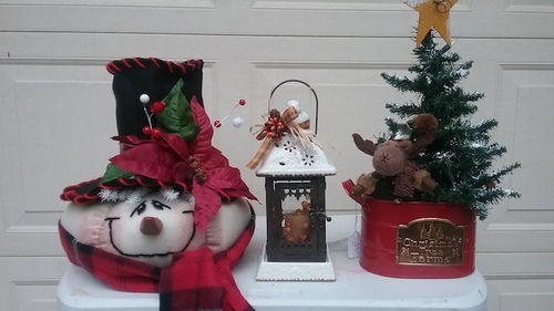 Youtsey soft sculpture snowman, metal lantern and tree stand with small Christmas tree.
