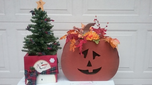 Youtsey handpainted wooden pumpkin and snowman tree stand with Christmas tree.