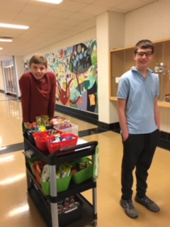 Saline High School Special Ed student working with the snack cart